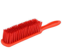 carpet brush. red plastic carpet brush