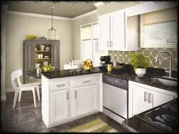white kitchen cabinets with dark granite countertops brown wooden floor rectangle islands beige table laminate dining