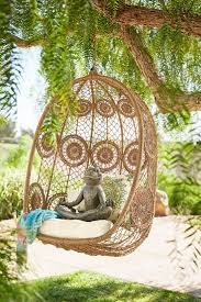 pier 1 s hanging swingasan chairs are always up for a good time and we ve given la fleur a lighthearted twist by weaving our synthetic rattan in a