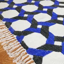 cane rug blue black