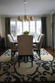 area rug over carpet in dining room