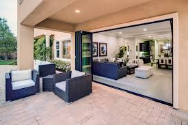 new bi fold door inspires upgrades for outdoor living builder doors design exteriors outdoor kitchens outdoor rooms western window systems