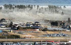 tsunami water wave com a massive tsunami generated by a powerful undersea earthquake engulfing a residential area in