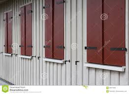 Wooden House Exterior With Closed Window Shutters Stock Photo - Shutters window exterior