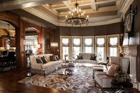 elegant furniture and lighting. this picture shows a living room rich in nice wooden tones and elegant furniture lighting sets n