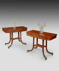 a pair of regency rosewood card tables with beautiful ormolu detailing