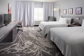 a bed or beds in a room at hilton garden inn dallas arlington south