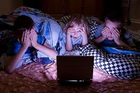 kids watching tv at night. image kids watching tv at night