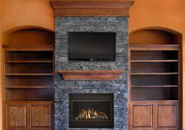 fantastic natural stone wood burning fireplace surround with brown f finish oak mantel shelf under floating tv units 2517x1769