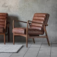 retro style leather armchair with a distressed brown leather and retro wooden frame