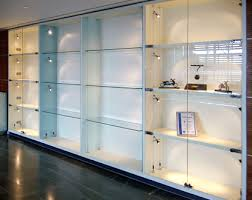 cabinet wall display with integral suspended shelving carrying low voltage lighting from kit s t z lighting range