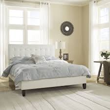 The Waverly Platform Bed is upholstered with white faux leather and has a  button tufted headboard