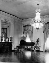 view of a chandelier and a piano in the east room of the white house