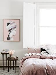 styled pink bedroom image with artwork