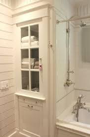 bathroom storage cabinet glass door