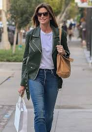 cindy crawford donning a relaxed fit dark leaf green leather jacket with full