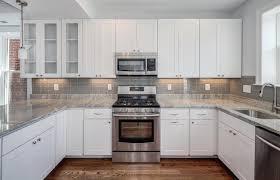 astounding gray kitchen backsplash with brown floor