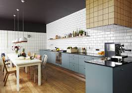 Image Kitchen Backsplash View In Gallery Compare These Two Amazingly Similar But Different Kitchens Thumb 630xauto 53801 White Subway Tile Kitchen Trendir White Subway Tile Kitchen Designs Are Incredibly Universal Urban Vs