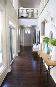 fall entryway with dark hardwood floors and blue