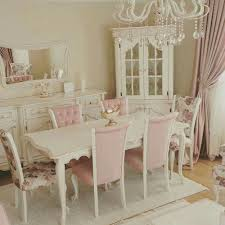 cottage chic furniture. shabby chic white and pale pink dining room with chandelier mismatched chairs cottage furniture
