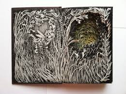 have you ever tried to re purpose an old book isobelle ouzman an artist based in seattle transforms them into beautiful book carvings