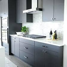 dark gray flat front kitchen cabinets with mosaic tile quartz countertops white