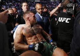 McGregor breaks leg in latest UFC loss ...