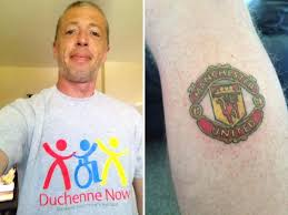 Manchester City Fan Gets Manchester United Badge Tattoo After