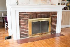 want an easy fireplace update learn how to spray paint that brass insert with this