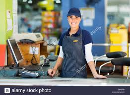 Beautiful Woman Working As A Cashier At The Supermarket