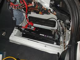 bmw 5 series where is the battery and fuse box located auto the battery and the fuse box on the 5 series bmw 525i is located in the trunk on the right passengers side behind the panel to remove the panel you must
