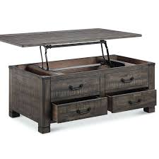 industrial lift top coffee table check out this lift top coffee table from birch lane its got four drawers for safe keeping plus even more storage inside