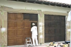 can you paint a garage door faux garage doors paint garage door with roller