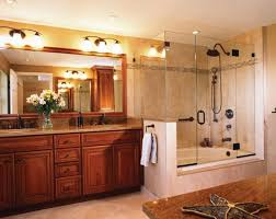 view in gallery cherry wood vanity and large glass shower and bathtub enclosure give this bathroom a classic touch