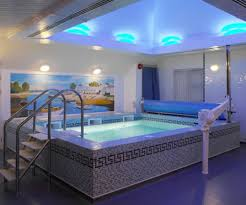 indoor pool bar. Adorable Wall Mural With Stylish LED Lights For Best Indoor Swimming Pool Design Metal Bar H