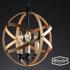 made from repurposed 14 quilting hoops and an old table lamp includes a 3