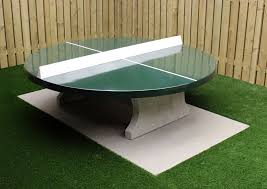 ping pong table round with green playing surface