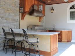 outdoor kitchen design center naples inspirational a covered patio boasts a mediterranean style outdoor kitchen filled