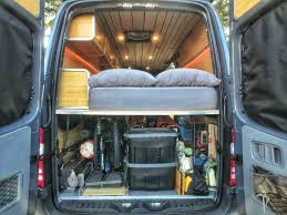view of converted van with sleeping platform