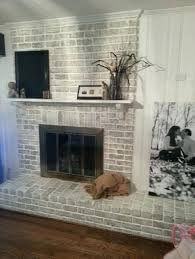 painted white brick fireplace with white