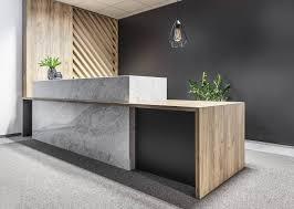 reception office reception desk stone timber screen inspiration