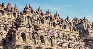 famous ancient architecture. Tourists Visiting Famous Ancient Buddhist Landmark Borobudur Temple In Java Indonesia Architecture