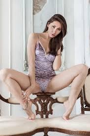 Long legged woman masturbates