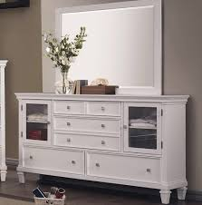 white dresser with glass doors