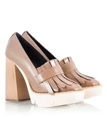 dalila tan leather kiltie panel chunky heel platform pumps