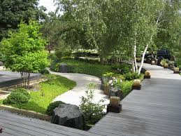 amazing decoration of japanese garden design with wooden path also trees  plus grasses