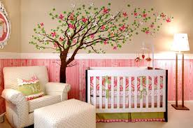 modern baby girl nursery ideas crystal chandelier gray color peach fitted heet blue painted crib colorful