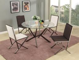 beveled edge round glass dining table with four chairs