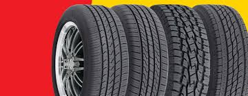 a lineup of tires on a red and yellow background
