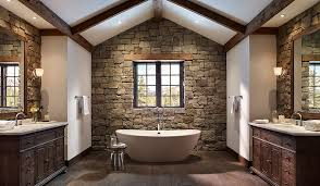rustic stone bathroom designs. rough cut stone wall and wooden ceiling beams create a cozy ambiance in the bathroom [ rustic designs .